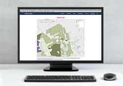 Data dashboard showing map on desktop computer/