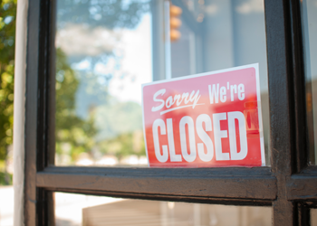 Closed sign in a store window.